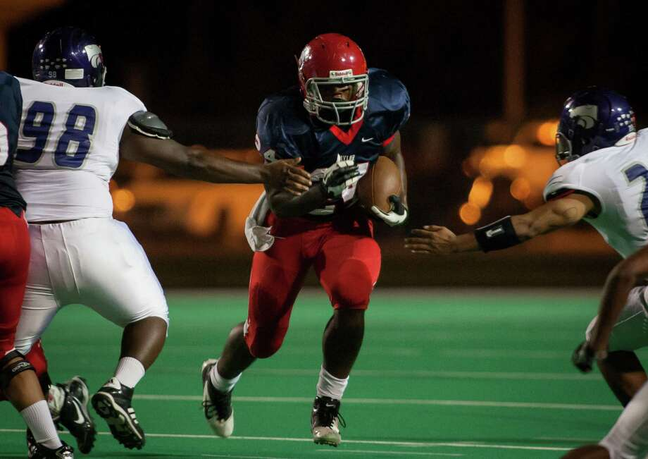 Alief Taylor running back Trevorris Johnson attempts a rush in the third quarter. Photo: Andrew Richardson, For The Chronicle / © 2012 Andrew Richardson