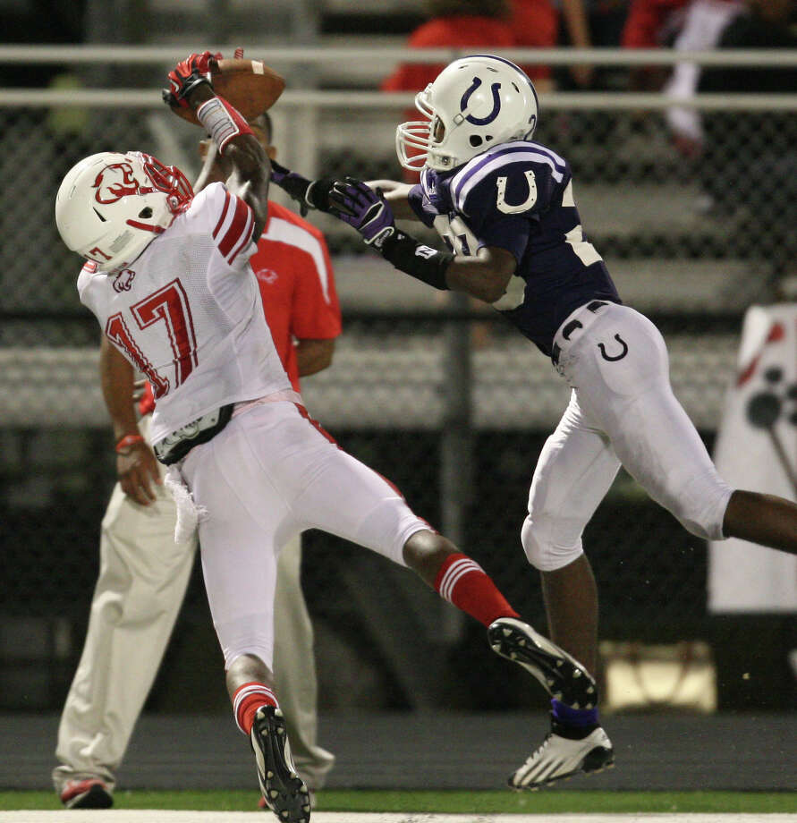 Dayton's Jacarius Keener (right) breaks up a pass intended for Crosby's Justin Walter during the second half of a high school football game, Friday, September 21, 2012 at Bronco Stadium in Dayton, TX. Photo: Eric Christian Smith, For The Chronicle
