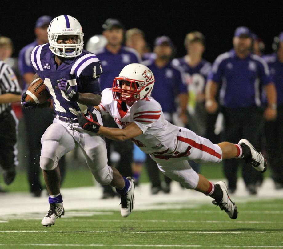Dayton running back Ryan McBride (15) is tackled by Crosby's Logan Porter during the second half of a high school football game, Friday, September 21, 2012 at Bronco Stadium in Dayton, TX. Photo: Eric Christian Smith, For The Chronicle