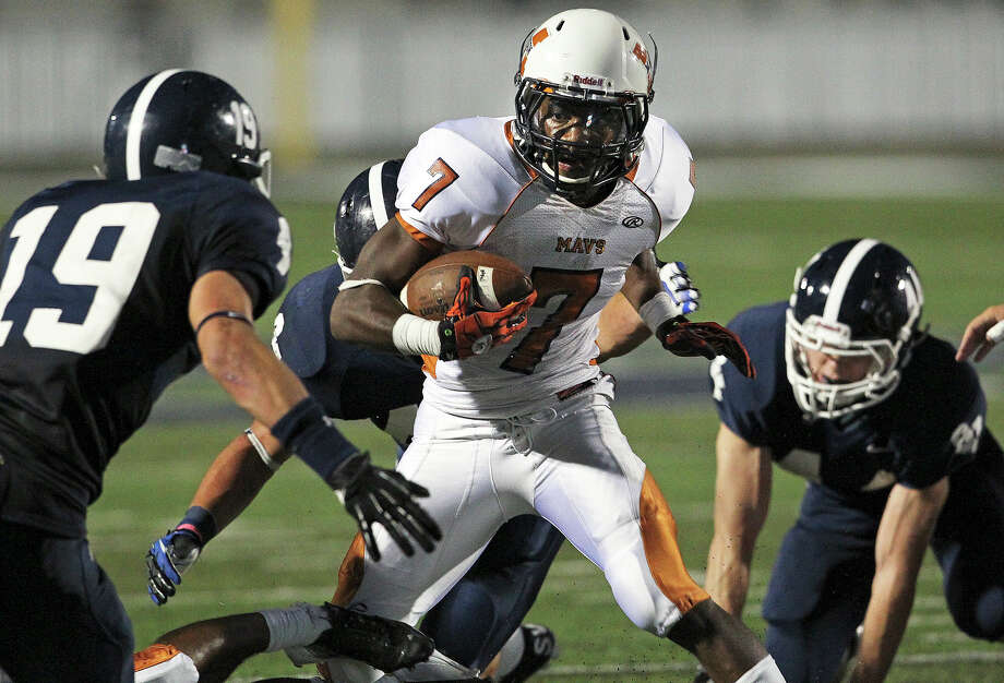 Ranger tacklers trap Marquise Warford in the first half as Smithson Valley hosts Madison on September 21, 2012. Photo: Tom Reel, Express-News / ©2012 San Antono Express-News