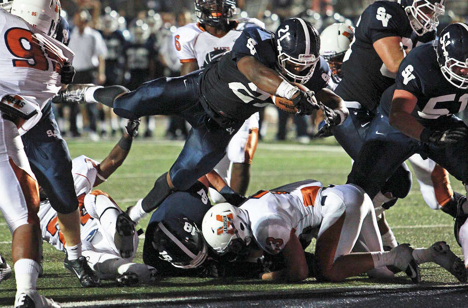 Ranger running back Lawrence Mattison jumps in for a second quarter touchdown as Smithson Valley hosts Madison on September 21, 2012. Photo: Tom Reel, Express-News / ©2012 San Antono Express-News