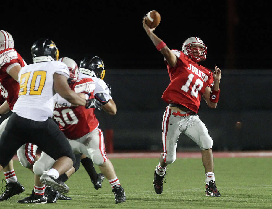Judson quarterback Rayjohn Austin-Ramsey (10) attempts a pass against East Central during their game at D.W. Rutledge Stadium on Friday, Sept. 21, 2012. Photo: Kin Man Hui, Express-News / ©2012 San Antonio Express-News