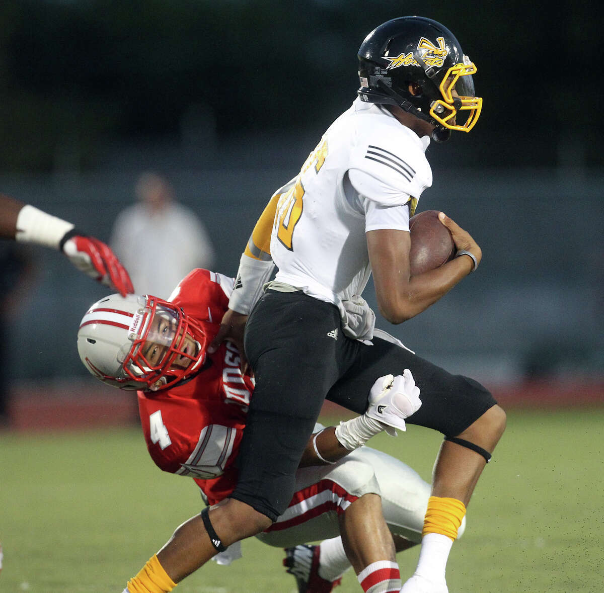 Judson's Malik Pryor (04) attempts to take down East Central quarterback Jeremy Jones (16) during their game at D.W. Rutledge Stadium on Friday, Sept. 21, 2012.