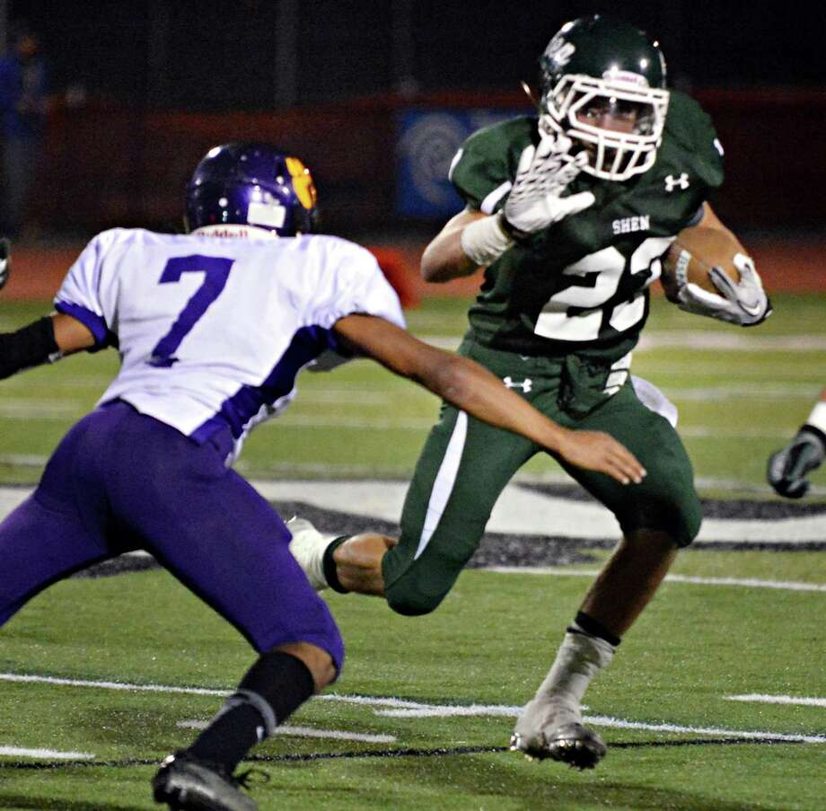 Shen's #23 Kyle Buss blasts by Ballston Spa's #7 Kiernan Mack during Friday night's game in Clifton Park Sept. 21, 2012.  (John Carl D'Annibale / Times Union) Photo: John Carl D'Annibale / 00019289A