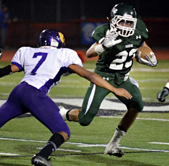 Shen's #23 Kyle Buss blasts by Ballston Spa's #7 Kiernan Mack during Friday night's game in Clifton