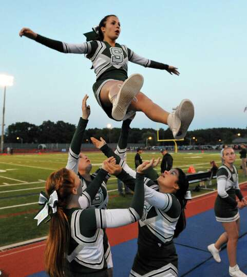 Shen cheerleader Jensen Mortka, top, during Friday night's game against Ballston Spa in Clifton Park