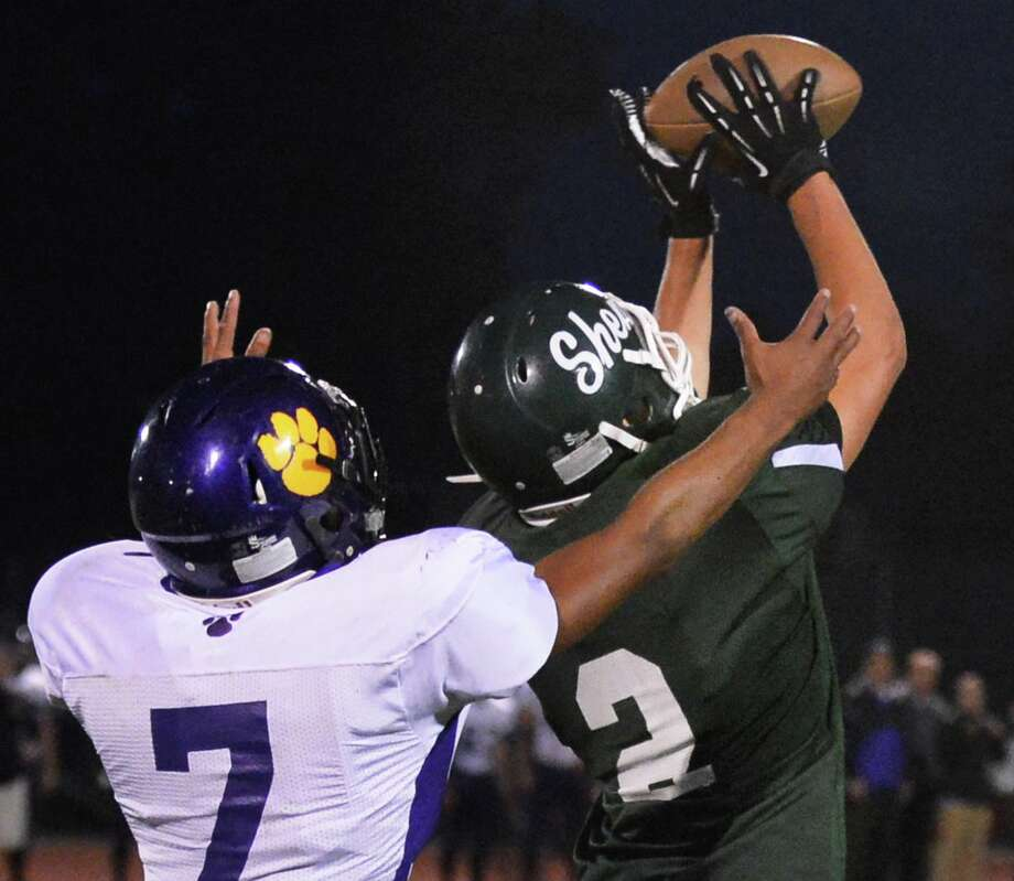 Shen's #2 DJ Edick intecepts a pass meant for   Ballston Spa's #7 Kiernan Mack during Friday night's game in Clifton Park Sept. 21, 2012.  (John Carl D'Annibale / Times Union) Photo: John Carl D'Annibale / 00019289A