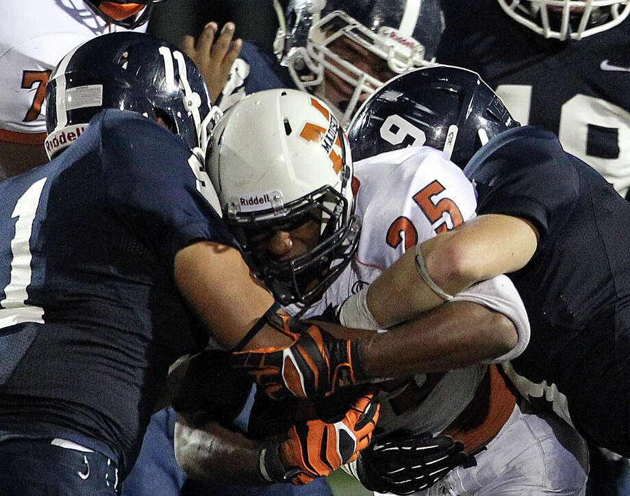 Maverick running back Galen McAllister is smothered in the middle as Smithson Valley hosts Madison on September 21, 2012. Photo: Tom Reel, Express-News / ©2012 San Antono Express-News