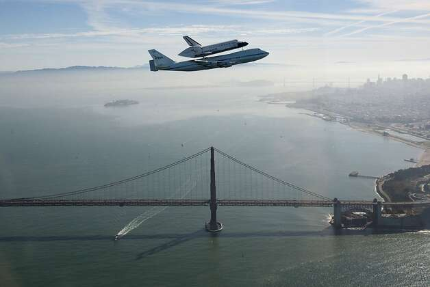 The space shuttle Endeavour, piggybacking on a modified 747 carrier aircraft, soars over the Golden Gate Bridge. Photo: Carla Thomas, Associated Press