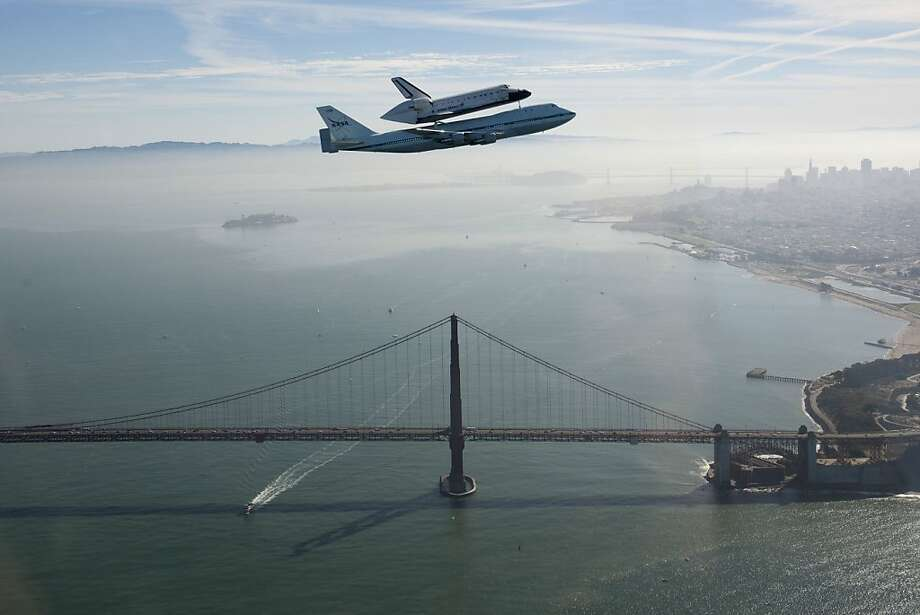 In this photo provided by NASA, space shuttle Endeavour and its modified 747 carrier aircraft soar over the Golden Gate Bridge in San Francisco during the final portion of its tour of California, Friday, Sept. 21, 2012. (AP Photo/NASA, Carla Thomas) Photo: Carla Thomas, Associated Press