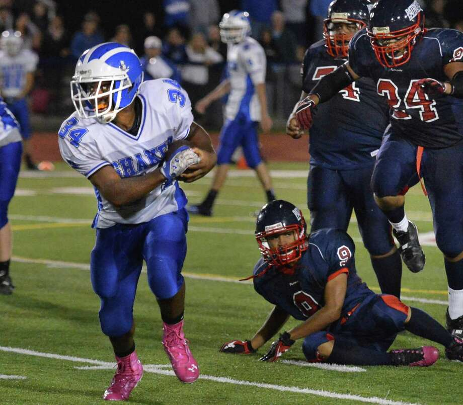 Shaker's #34 Kenny Jackson out runs Schenectady High's defense during Friday night's game in Schenectady Sept. 21, 2012.  (John Carl D'Annibale / Times Union) Photo: John Carl D'Annibale / 00019288A