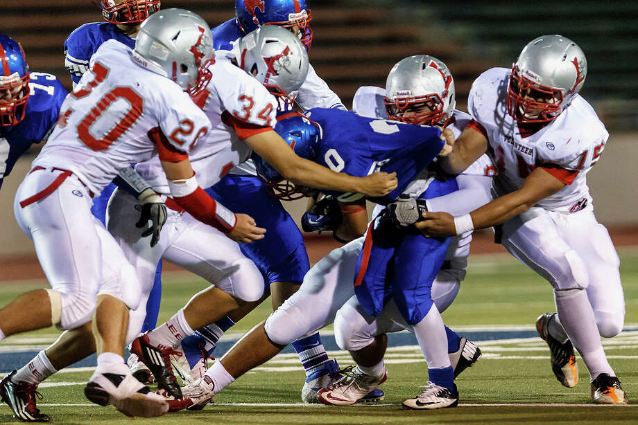Jefferson running back Joseph Luna is stopped by Lee's Sam Adams (from left), Nick Allie, Alex Lugo and James Hernandez during their game at Alamo Stadium  on Sept. 21, 2012.  MARVIN PFEIFFER/ mpfeiffer@express-news.net Photo: MARVIN PFEIFFER, Express-News / Express-News 2012