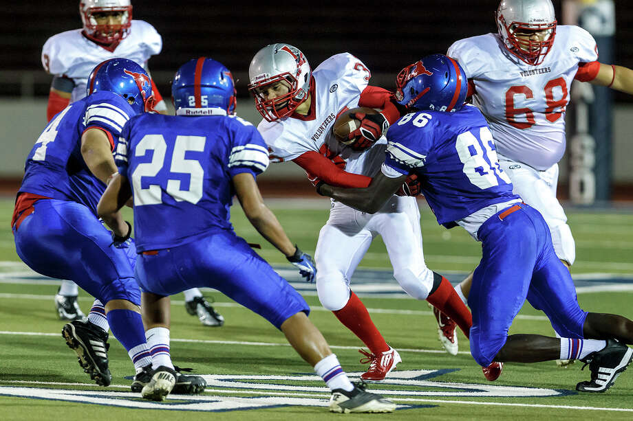 Lee runing back Josh Caulk (center) is bottled up by Jefferson's Ethan Mitreles (from left), Justin Lujan and Maurice Hudspeth during their game at Alamo Stadium  on Sept. 21, 2012.  MARVIN PFEIFFER/ mpfeiffer@express-news.net Photo: MARVIN PFEIFFER, Express-News / Express-News 2012