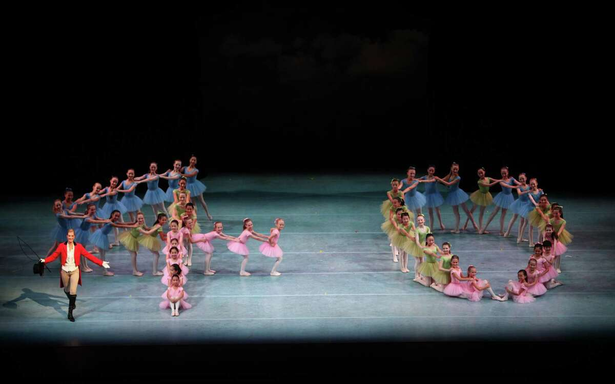 Former PNB ballerina Patricia Barker, dances as the ringmaster, as da ncers form the number 40 as they perform