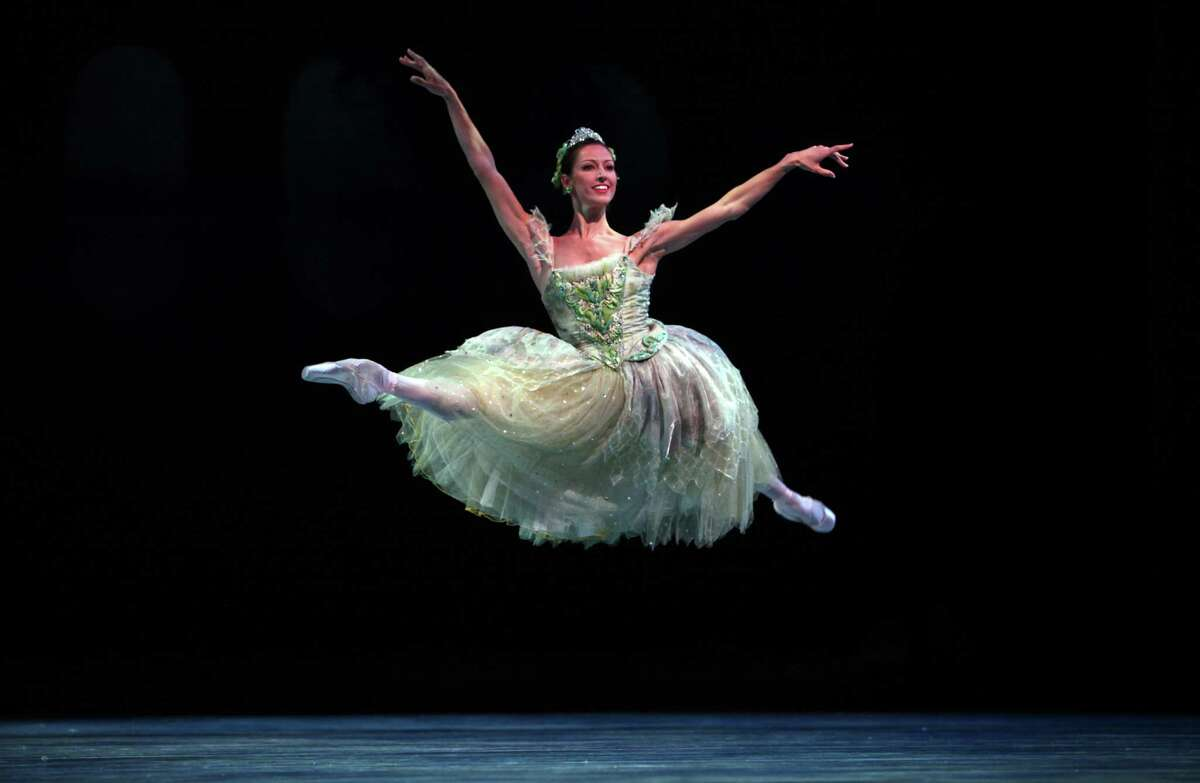 Dancer Maria Chapman performs during a Pacific Northwest Ballet performance of Cinderella at McCaw Hall. Cinderella kicks off PNB's 40th season.