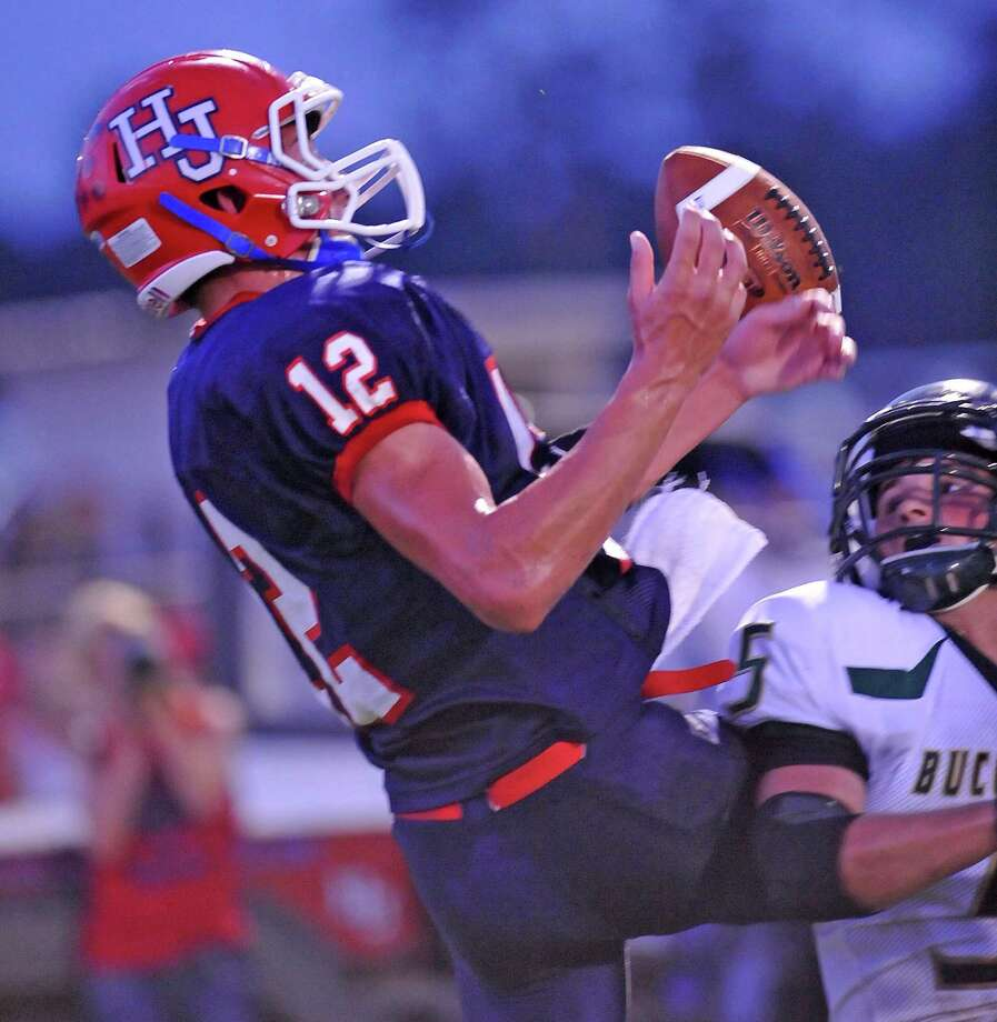 Hawks #12, Andrew Martel, left, barely misses the pass as Buccaneer #5, Cody Martin, right, hits him on the thigh.  The East Chambers Buccaneers football team played the Hardin-Jefferson Hawks at 7:00 p.m. Friday night at Hawk Stadium.  At the half, the Hawks were ahead 6-0.  Dave Ryan/The Enterprise Photo: Dave Ryan