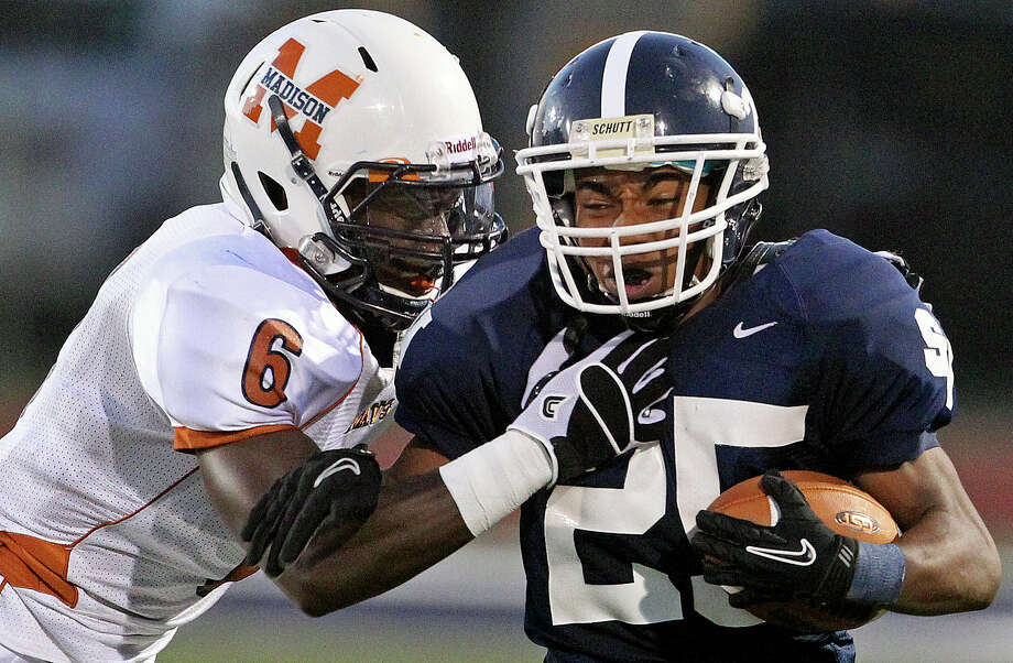 Ranger receiver Cameron Jones battles Dominique Daniels at the end of a run to the left as Smithson Valley hosts Madison on September 21, 2012. Photo: Tom Reel, Express-News / ©2012 San Antono Express-News