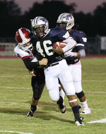 West Orange-Stark player Jhayllien Monette fights off a tackle during the game Friday at Dan R. Hook Stadium in West Orange. Photo: Matt Billot