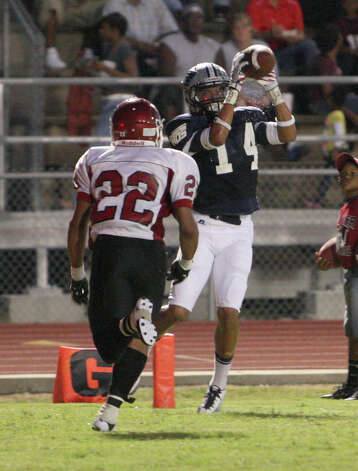 West Orange-Stark receiver J'Marcus Rhodes catches a touchdown during the game Friday at Dan R. Hook Stadium in West Orange. Photo: Matt Billot