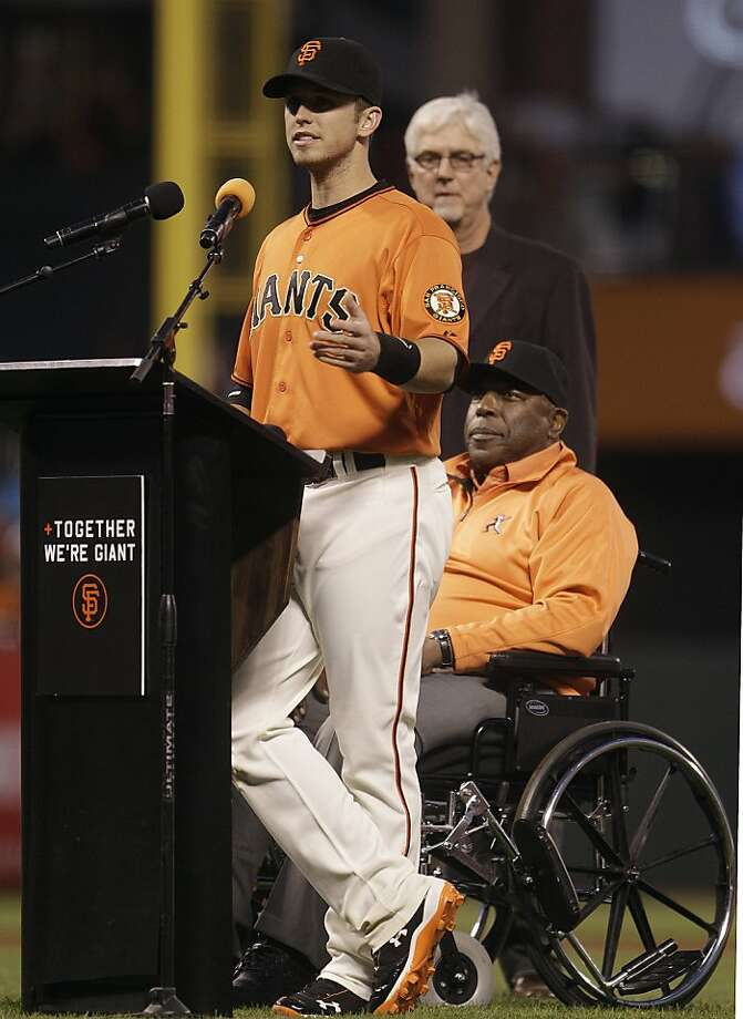 San Francisco Giants' Buster Posey, left, gestures beside former Giant Willie McCovey after receiving the Willie Mac award prior to the baseball game against the San Diego Padres, Friday, Sept 21, 2012, in San Francisco. (AP Photo/Ben Margot) Photo: Ben Margot, Associated Press
