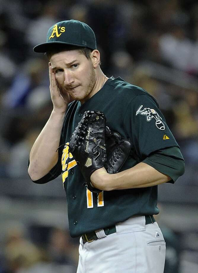Oakland Athletics starting pitcher Jarrod Parker  reacts after New York Yankees' Nick Swisher scored on a sacrifice fly by Curtis Granderson in the fourth inning of a baseball game on Friday, Sept., 21, 2012, at Yankee Stadium in New York. The Yankees won 2-1 in 10 innings. (AP Photo/Kathy Kmonicek) Photo: Kathy Kmonicek, Associated Press