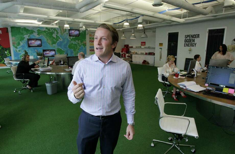 Edward Ogden, a director, talks about the open design, complete with artificial turf and eclectic office accessories at Spencer Ogden's office on Main.  Most of the 4,300-square-foot facility is devoted to one very large room. Photo: Melissa Phillip / © 2012 Houston Chronicle