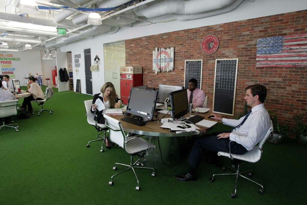 Employees Work In An Open Design Complete With Artificial Turf At The Spencer Ogden 811