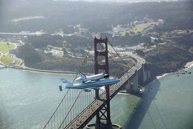 In this photo provided by NASA, space shuttle Endeavour and its 747 carrier aircraft soar over the Golden Gate Bridge in San Francisco during the final portion of its tour of California, Friday, Sept. 21, 2012. (AP Photo/NASA, Carla Thomas) Photo: Carla Thomas, Associated Press