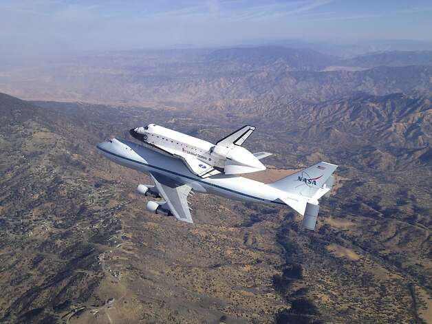 In this photo provided by NASA, the Space Shuttle Endeavour atop NASA's modified 747 carrier soars over the Tehachapi Mountains southeast of Bakersfield, Calif., during its tour of California, Friday, Sept. 21, 2012. After low-altitude flyovers of Sacramento, San Francisco, Los Angeles and numerous other communities and landmarks, the flight would conclude at Los Angeles International Airport where Endeavour would be turned over to the California Science Center for permanent exhibit. (AP Photo/NASA, Jim Ross) Photo: Jim Ross, Associated Press