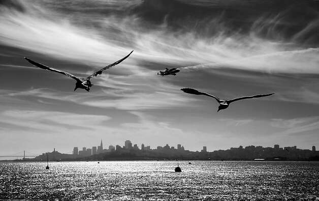 SAN FRANCISCO, CA - SEPTEMBER 21:   (EDITORS NOTE: Image has been converted to black and white.)  The space shuttle Endeavour makes a pass over San Francisco before making its final landing in Los Angeles on September 21, 2012 in San Francisco, California.  (Photo by Ezra Shaw/Getty Images) Photo: Ezra Shaw, Getty Images