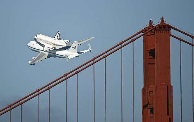 The space shuttle Endeavour passes over the Golden Gate Bridge in San Francisco, Friday, Sept. 21, 2012. Endeavour is making a final trek across the country to the California Science Center in Los Angeles, where it will be permanently displayed. (AP Photo/Michael Kass) Photo: Michael Kass, Associated Press