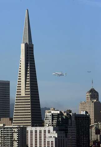 Space Shuttle Endeavour mounted on NASA's Shuttle Carrier Aircraft, flies past Transamerica Pyramid on Friday, Sept. 21, 2012, in San Francisco. Endeavour is making a final trek across the country to the California Science Center in Los Angeles, where it will be permanently displayed. (AP Photo/San Francisco Chronicle, Carlos Avila Gonzalez)  NORTHERN CALIFORNIA MANDATORY CREDIT PHOTOG & CHRONICLE; MAGS OUT; NO SALES. Photo: Carlos Avila Gonzalez, Associated Press