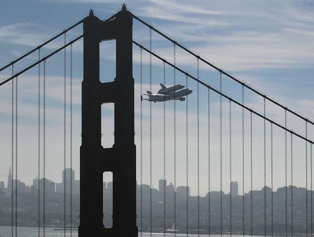 Space Shuttle Endeavour mounted on NASA's Shuttle Carrier Aircraft, flies above the Golden Gate Bridge past the Marin Headlands in Sausalito, Calif., Friday, Sept. 21, 2012.  Endeavour is making a final trek across the country to the California Science Center in Los Angeles, where it will be permanently displayed. (AP Photo/San Francisco Chronicle, Paul Chinn)  NORTHERN CALIFORNIA MANDATORY CREDIT PHOTOG & CHRONICLE; MAGS OUT; NO SALES Photo: Paul Chinn, Associated Press
