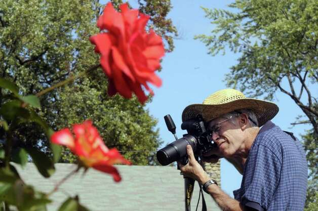 Russell Jenkins of Galway takes photographs at the Central Park Rose Garden in Schenectady, NY Friday Sept. 21, 2012. (Michael P. Farrell/Times Union) Photo: Michael P. Farrell