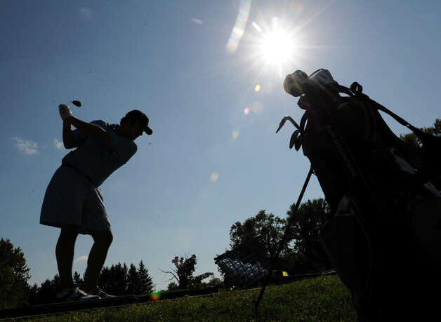 Eric Messina of Latham practices his drives and short game on a driving range Thursday, Sept. 20, 2012 at Wolferts Roost Country Club in Albany, N.Y. (Lori Van Buren / Times Union) Photo: Lori Van Buren