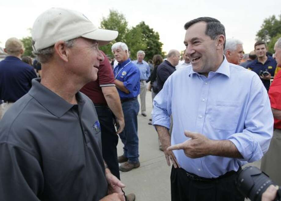 In this Aug. 3, 2012, file photo, Indiana Gov. Mitch Daniels, left, chats with Rep. Joe Donnelly, D-Ind., at the Indiana Pork Producers Ham Breakfast at the Indiana State Fair in Indianapolis. Donnelly is running for the U.S. Senate seat against Republican Richard Mourdock. Senate Republicans are jumping into Indiana's Senate race with a new ad, outdoing a recent buy from national Democrats as the parties battle for control of the Senate. Spending in Indiana has quickly escalated as Donnelly has stayed neck and neck with Republican Richard Mourdock since May. Mourdock's primary victory over Sen. Richard Lugar created the opening for Democrats in Indiana. (Michael Conroy / Associated Press)