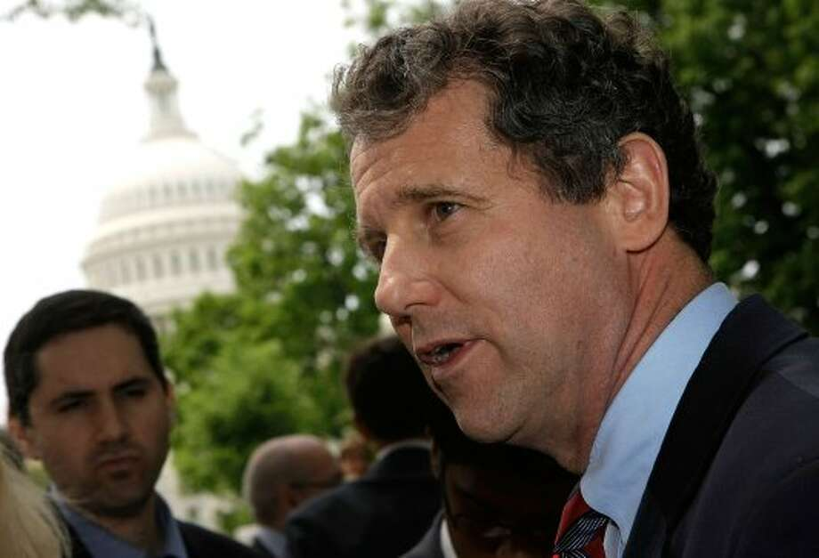 U.S. Sen. Sherrod Brown (D-OH) (R) speaks to reporters after a news conference at Upper Senate Park May 14, 2008 on Capitol Hill in Washington, DC. Brown held a news conference with Rep. Michael Michaud and union leaders to express their opposition to the U.S.-Columbia Free Trade Agreement. (Alex Wong / Getty Images)