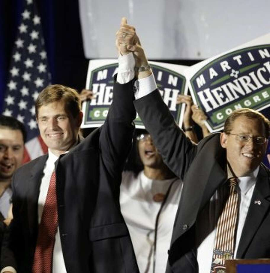 Representative elect Martin Heinrich, D-N.M., left, celebrates his election win with New Mexico Party chairman Brian Colon at a victory party in Albuquerque, N.M., Tuesday, Nov. 4, 2008. (LM Otero / AP)