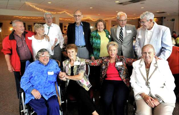 Members of the Danbury High School Class of 1947 who traveled from other states to attend their 65th reunion gather for a photograph Saturday, Sept. 22, 2012. Photo: Michael Duffy / The News-Times