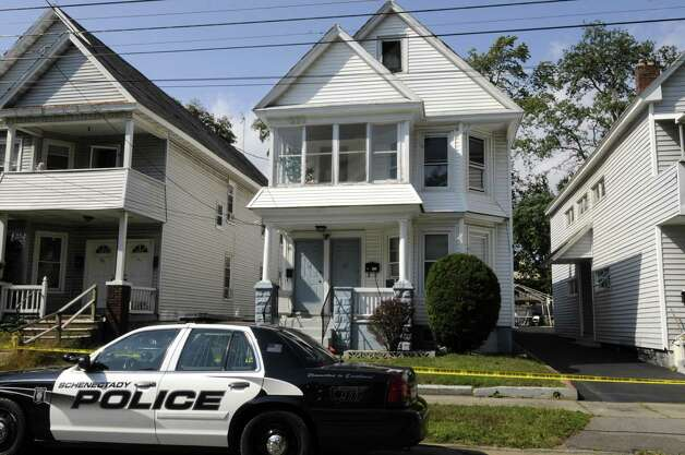 Scene of a stabbing at 65 Elm Street, center, in Schenectady, NY Saturday Sept. 22, 2012. (Michael P. Farrell/Times Union) Photo: Michael P. Farrell