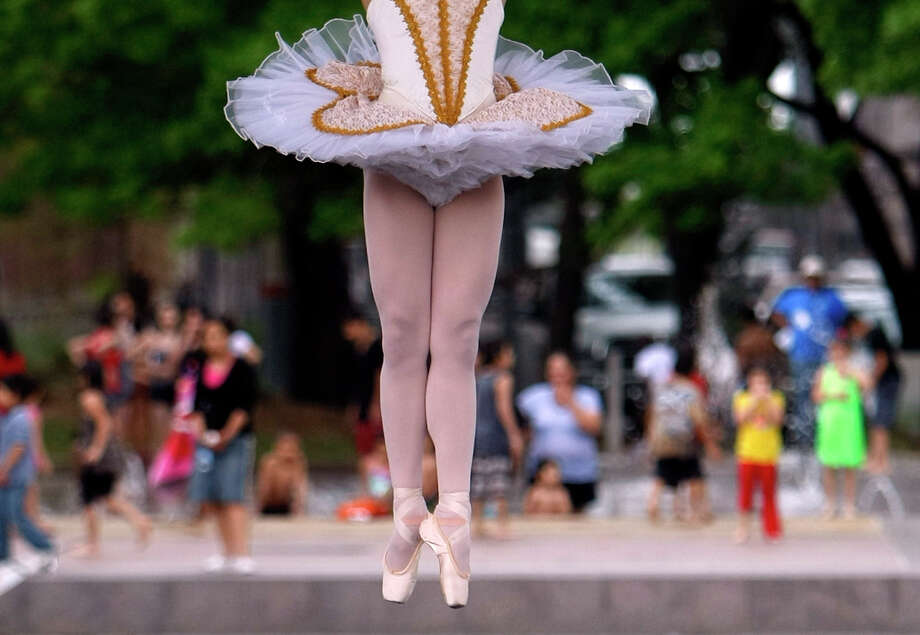 A member of the Houston Ballet performs downtown at Discovery Green in March. Eighty-two percent of those who replied to the Houston Arts survey strongly agreed that participation in the arts is important for children. Photo: Johnny Hanson / © 2012 Houston Chronicle