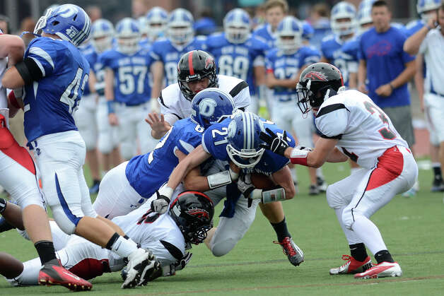 Darien's #21 Nicholas Lombardo encounters some resistance as Darien High School hosts Fairfield Warde High School in varsity football in Darien, CT on Sept. 22, 2012. Photo: Shelley Cryan / Shelley Cryan for the Stamford Advocate/ freelance Shelley Cryan