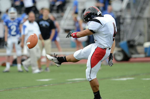 Warde's #4 Dawud Mohamed puts it in play as Darien High School hosts Fairfield Warde High School in varsity football in Darien, CT on Sept. 22, 2012. Photo: Shelley Cryan / Shelley Cryan for the Stamford Advocate/ freelance Shelley Cryan