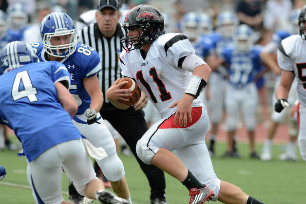 Warde's #11 Max Garrett runs upfield as Darien High School hosts Fairfield Warde High School in varsity football in Darien, CT on Sept. 22, 2012. Photo: Shelley Cryan / Shelley Cryan for the Stamford Advocate/ freelance Shelley Cryan