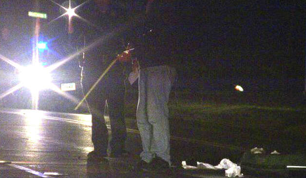Police check the scene where a skateboarder was hit by a car Friday night on North Benson Road. Photo: Doing It Local.com / Fairfield Citizen contributed