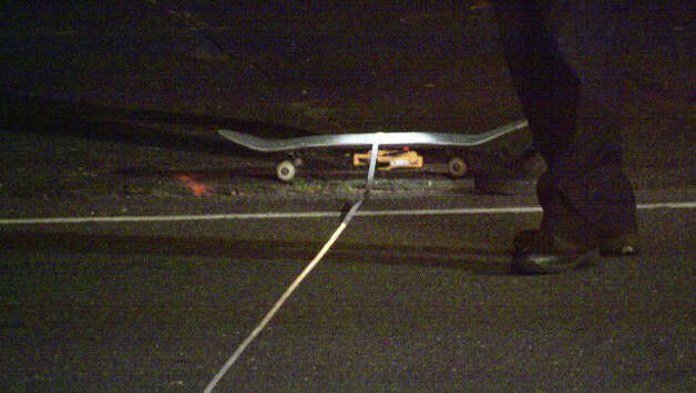A skateboard remains at the scene Friday night where a 16-year-old was struck by a car on North Benson Road. Photo: Doing It Local.com / Fairfield Citizen contributed