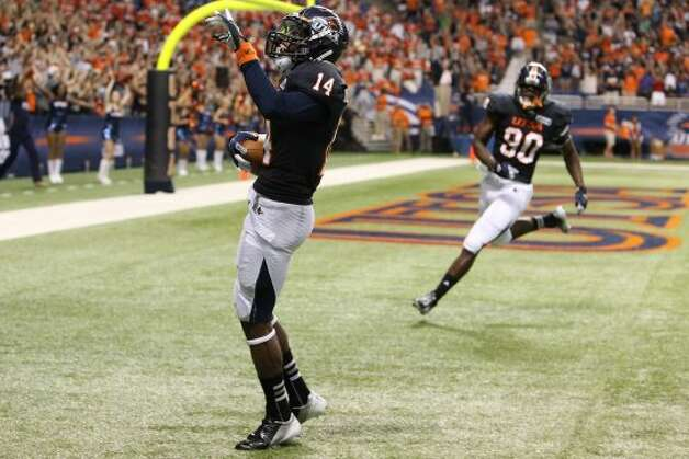 UTSA's Tristan Wade (14) celebrates after intercepting a pass for a touchdown against Northwestern Oklahoma State at the Alamodome on Saturday, Sept. 22, 2012. (Kin Man Hui / SAN ANTONIO EXPRESS-NEWS)