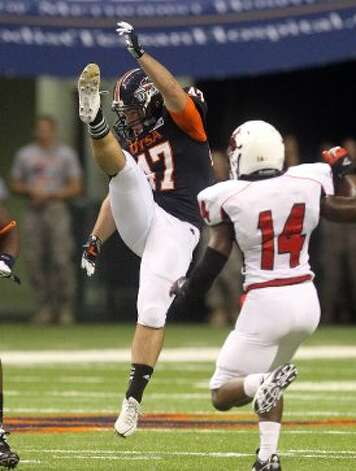UTSA punter Josh Ward (47) punts away the ball against Northwestern Oklahoma State at the Alamodome on Saturday, Sept. 22, 2012. (Kin Man Hui / SAN ANTONIO EXPRESS-NEWS)