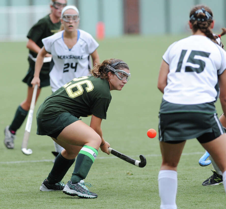 At center, Pam Schulman, # 26 of Greenwich Academy, plays a loose ball between Berkshire School players, Ronnie Lortie # 24, at left,  and Allegra Perekslis # 13, at right,  during the girls high school field hockey match between Greenwich Academy and the Berkshire School of Sheffield, Mass., at Greenwich Academy Saturday, Sept. 22, 2012. Photo: Bob Luckey / Greenwich Time