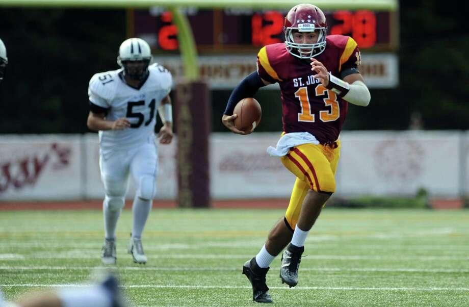 St. Joseph quarterback Jordan Vazzano runs for a 72-yard touchdown against Wilton Saturday, Sept. 22, 2012 at St. Joseph High School in Trumbull. Photo: Autumn Driscoll / Connecticut Post